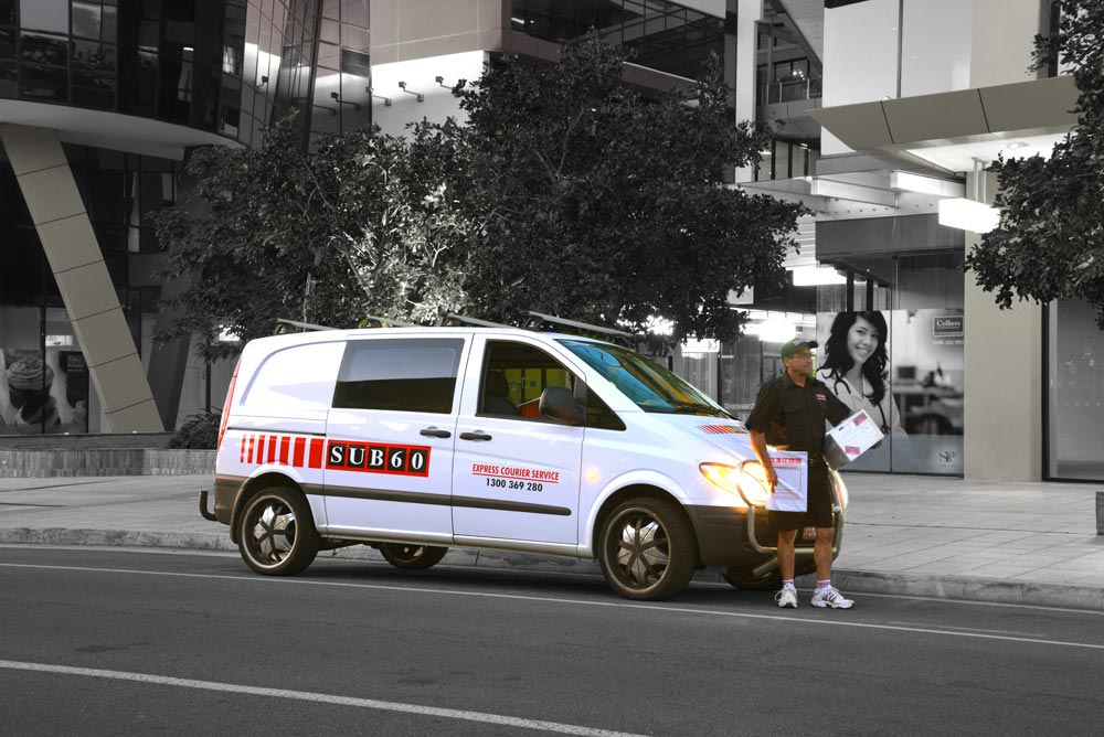 SUB60 Express Courier Service - Man delivering boxes in the city